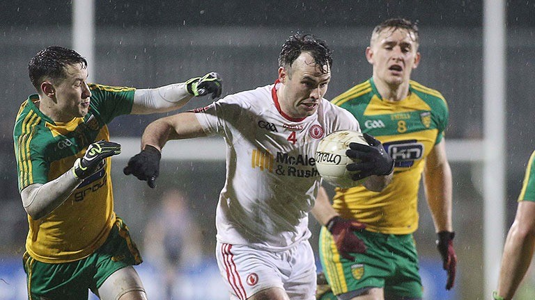 Tyrone's Cathal McCarron advances under pressure
