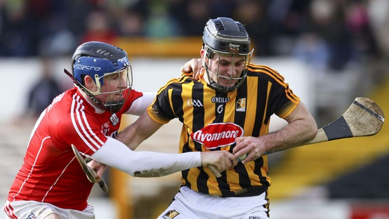 Cork hurler Conor Lehane (red) battles for the ball