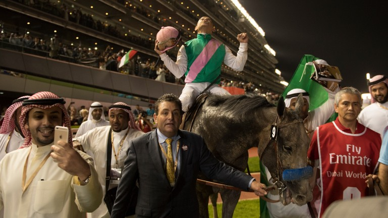 Sheer delight: Mike Smith enjoys the moment after Arrogate's incredible success