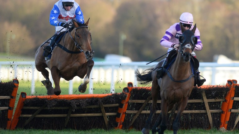 Reve De Sivola and Daryl Jacob (left) jump the last before giving winning chase to Zarkandar in the 2014 Long Walk Hurdle at Ascot