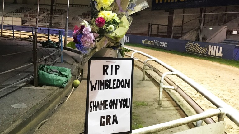 Protest: a sign was erected and flowers were laid by workers angered by the track's closure