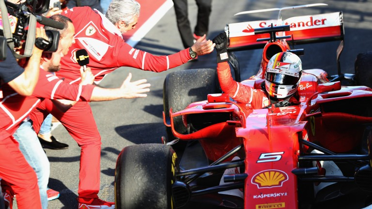 Sebastian Vettel is welcomed back to the pitlane after ending Ferrari's 28-race losing run in the Australian Grand Prix