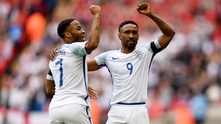 Jermain Defoe (number nine) celebrates his goal with Raheem Sterling