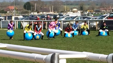The field for the annual Plumpton space hopper race sets off on its way down the track