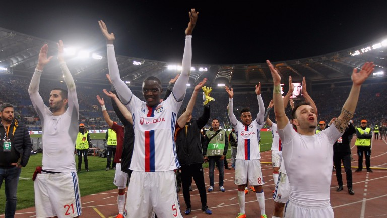 Lyon celebrate beating Roma in the Europa League