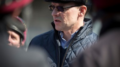 Aidan O'Brien issues instructions to his work riders at Naas