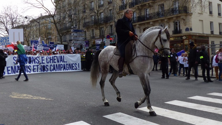 Top equestrian display rider Mario Luraschi leads the march in Paris on Wednesday