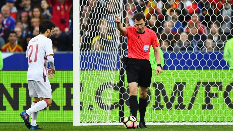 Referee Felix Zwayer awards Spain's second goal against France after a review