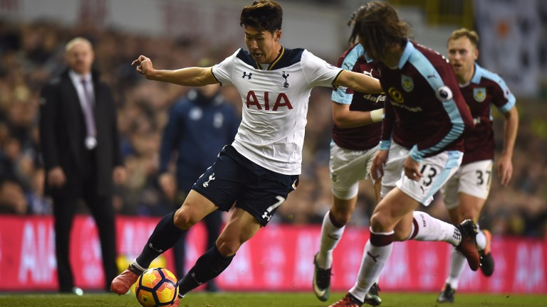 Heung-Min Son of Tottenham weaves his way past Jeff Hendrick of Burnley