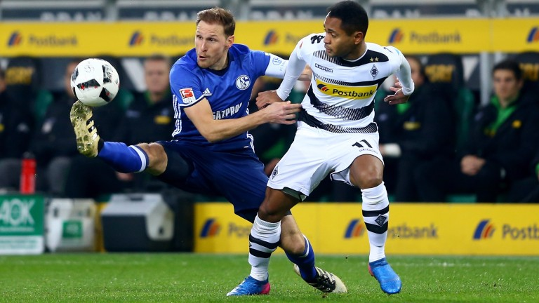 Benedikt Howedes (left) of Schalke will be tasked with neutralising Pierre-Emerick Aubameyang