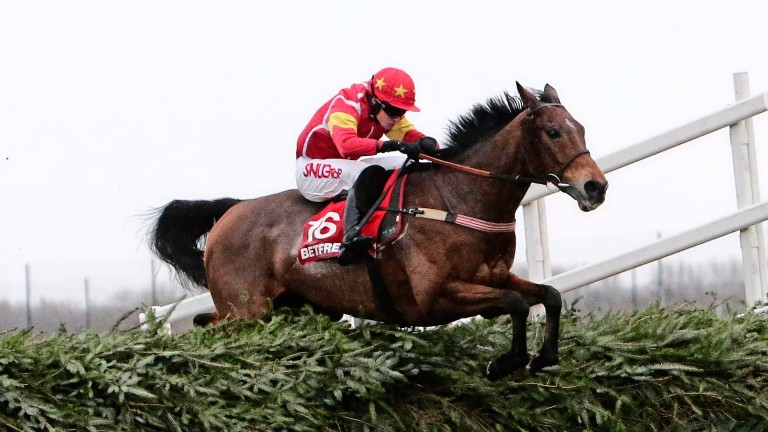 Highland Lodge and Henry Brooke on the way to victory in the 2015 Becher Chase