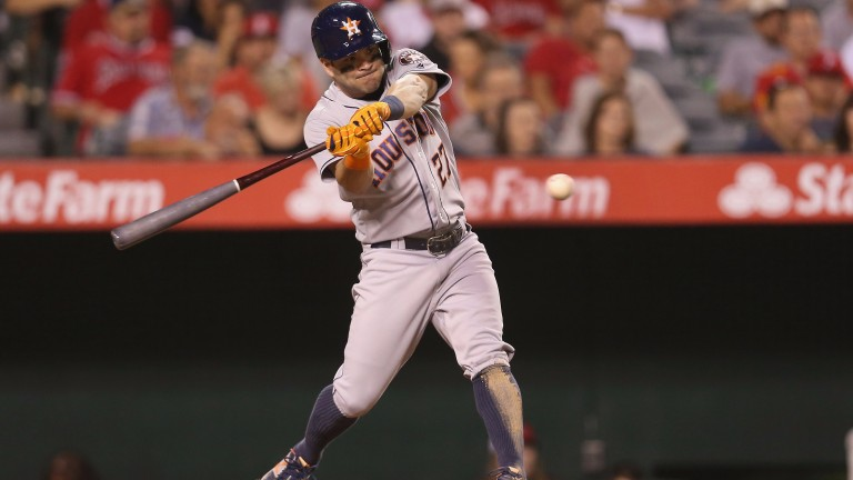 Venezuelan second baseman Jose Altuve hits out for the Houston Astros last season