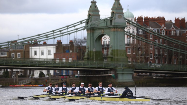 Oxford row past Hammersmith Bridge in one of their warm-up races