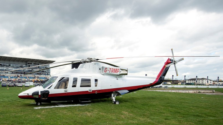 Richard Hannon and the the owners of first-race winner Tupi, Michael Kerr-Dineen and Martin Hughes arrived at Doncaster in this helicopter owned by Donald Trump