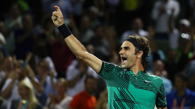 Roger Federer celebrates winning match point against Nick Kyrgios