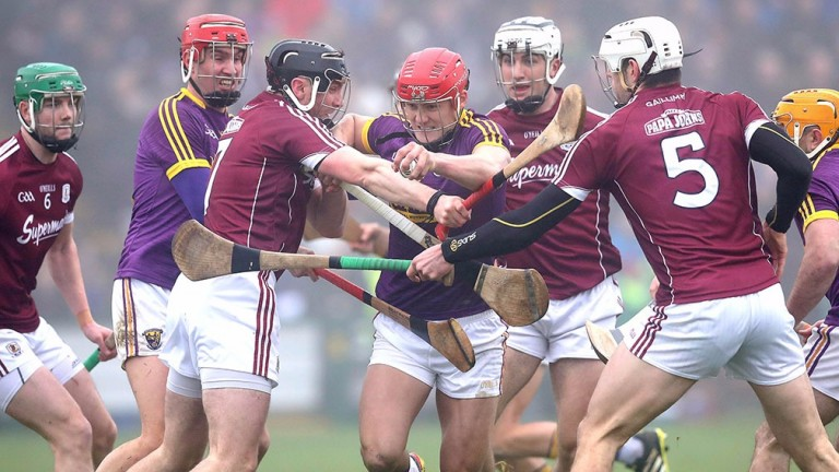 Galway's Aidan Harte and Geroid McInerney battle with Wexford's Lee Chin