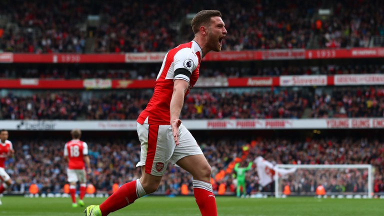 Shkodran Mustafi celebrates Arsenal's equaliser in the 2-2 draw against Manchester City