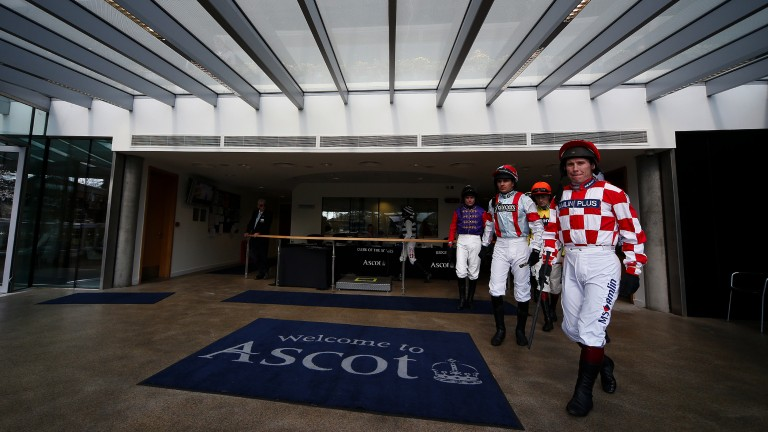 Ready to go: Richard Johnson leads the jockeys out of the weighing room before the opener