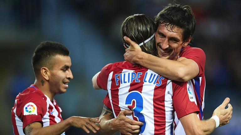 Atletico Madrid moved into the top three after beating Malaga
