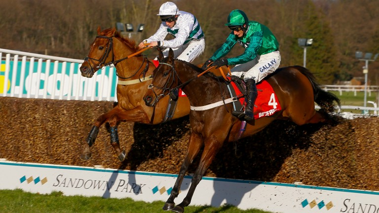 Top Notch and Daryl Jacob (nearside) win the Grade 1 Scilly Isles Novices´ Chase at Sandown