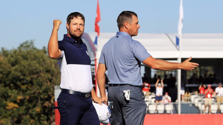 Ryan Moore celebrates winning his match at the Ryder Cup against Lee Westwood