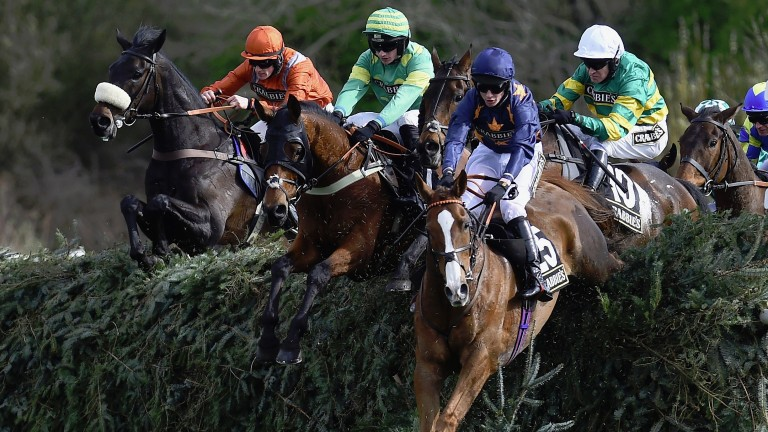 LIVERPOOL, ENGLAND - APRIL 08:  Eastlake (centre) ridden by Barry Geraghty jumps  Canal Turn behind leader Fairy Rath ridden by Tom Cannon during The Crabbies Topham Steeple Chase at Aintree Racecourse on April 8, 2016 in Liverpool, England.  (Photo by La
