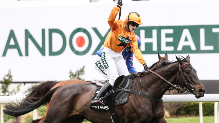 Lizzie Kelly celebrates as Tea For Two edges out Cue Card in the Betway Bowl at Aintree