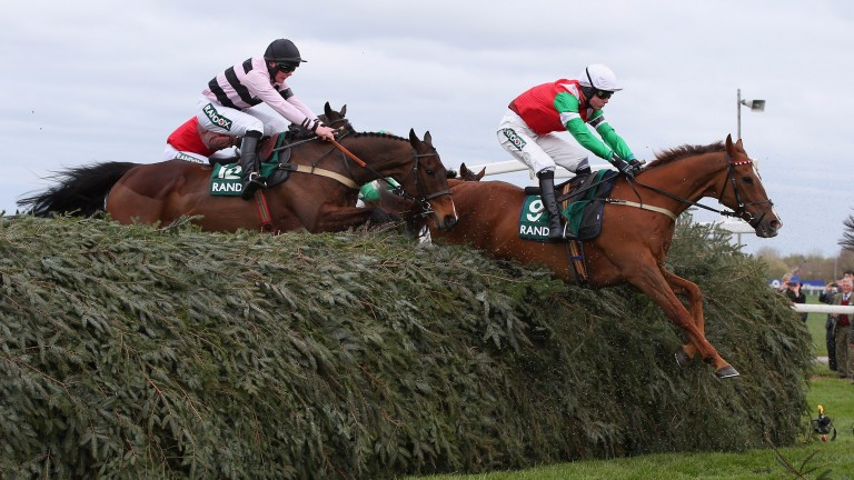 Dineur and James King clear The Chair on their way to victory in the Randox Health Foxhunters'