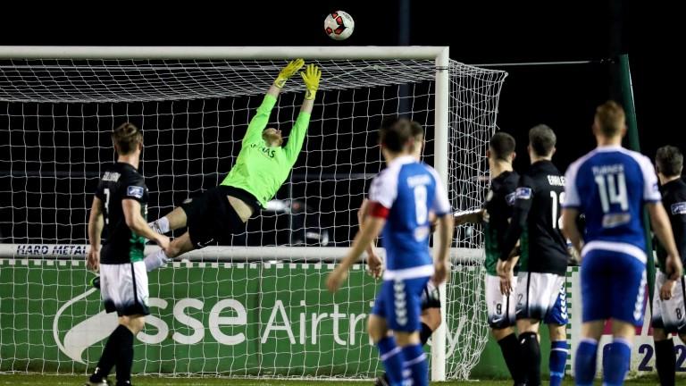 Bray goalie Peter Cherrie dives for the ball against Limerick
