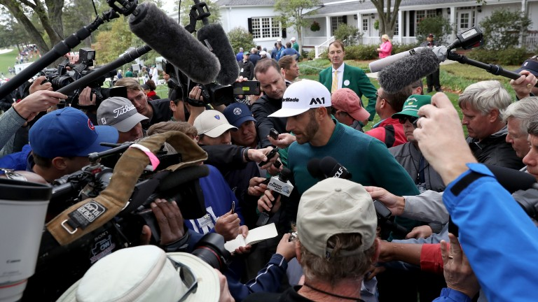 Dustin Johnson is swamped by media