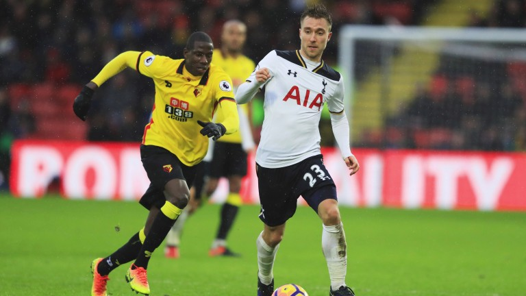Watford's Abdoulaye Doucoure chases Christian Eriksen