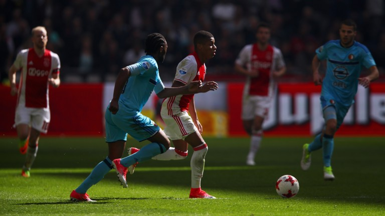 Feyenoord (light blue) battle Ajax in the Eredivisie