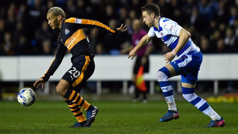 Newcastle's Yoan Gouffran (left) holds off the challenge of Chris Gunter of Reading