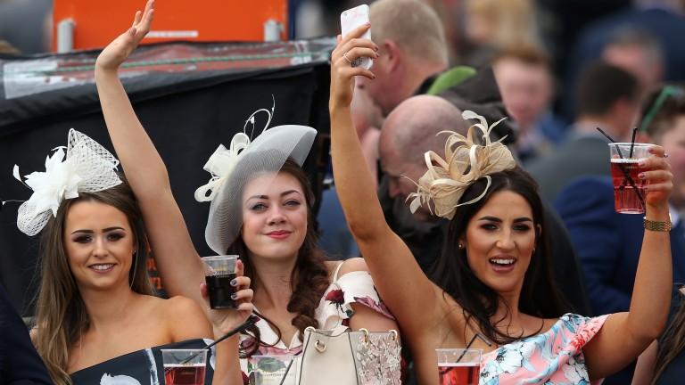 Fun in the sun: Racegoers enjoy the good weather on ladies' day