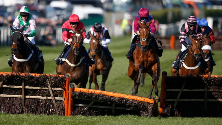 The Worlds End (maroon sleeves and cap) flattens the final hurdle on his way to a game win in the Doom Bar Sefton Novices' Hurdle