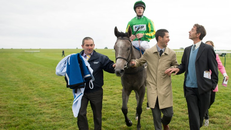 Trainer Jonathan Portman (right) greets Mrs Danvers and Richard Kingscote after the Cornwallis Stakes at Newmarket