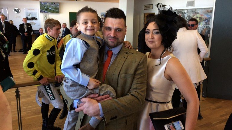 Bradley Lowery, with parents Carl and Gemma, in the Aintree weighing room
