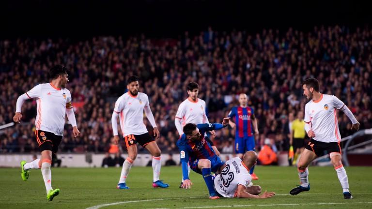 Valencia players shut down Barcelona's Lionel Messi