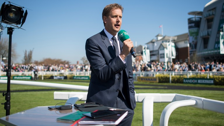 ITV anchorman Ed Chamberlin broadcasts from Aintree