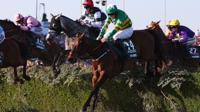 LIVERPOOL, ENGLAND - APRIL 08:  Cause of causes ridden Jamie Codd clears the Water Jump on their way to second place in the 2017 Randox Health Grand National at Aintree Racecourse on April 8, 2017 in Liverpool, England.  (Photo by Alex Livesey/Getty Image