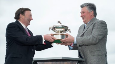 Nicky Henderson and Paul Nicholls pose with the trainers' championship trophy at Aintree