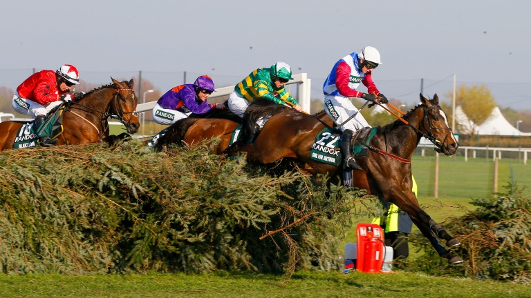 Blaklion (left) jumps the last in fourth having been swallowed up by the principals