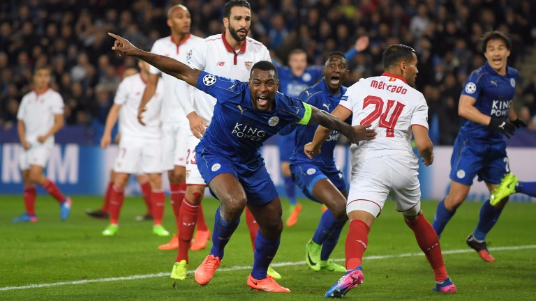 Leicester captain Wes Morgan celebrates against Seville