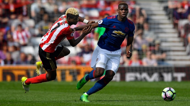 Paul Pogba of United brushes off the challenge of Didier Ndong of Sunderland