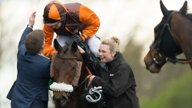 Neil Mulholland greets The Young Master and Sam Waley-Cohen after their victory in the bet365 Gold Cup at Sandown last year