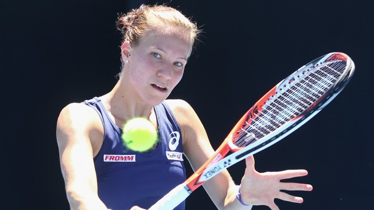 Switzerland's Viktorija Golubic returns a backhand
