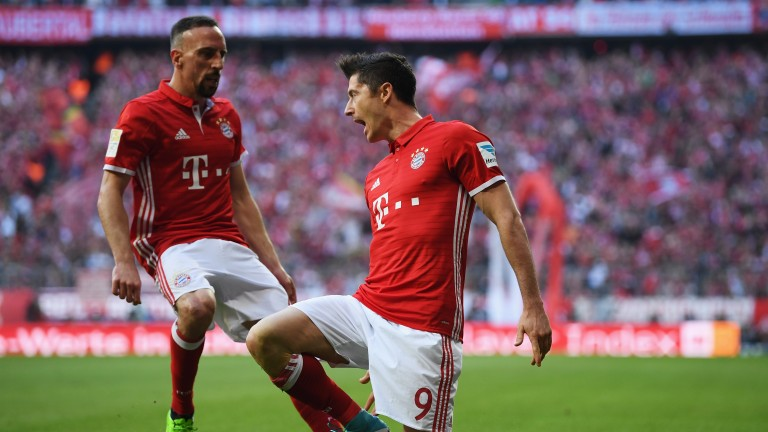 Bayern Munich's Robert Lewandowski (number nine) celebrates with Franck Ribery