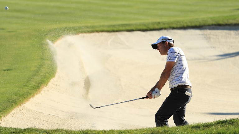 Kevin Kisner plays a shot from a bunker during the Arnold Palmer Invitational