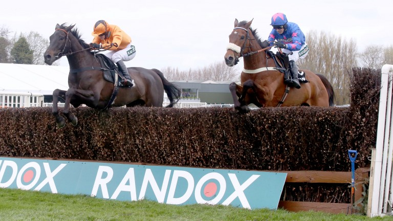 Tea For Two and Lizzie Kelly (orange silks) on the way to defeating Cue Card at Aintree