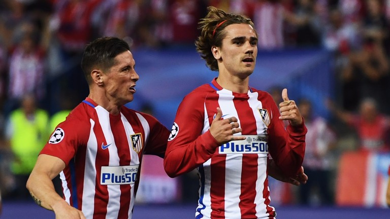 Antoine Griezmann (right) celebrates with Fernando Torres after scoring against Leicester in the Champions League